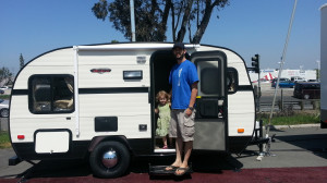 """The smallest travel trailer I've ever seen! Branndon is 6'3"""" so you have a size reference."""